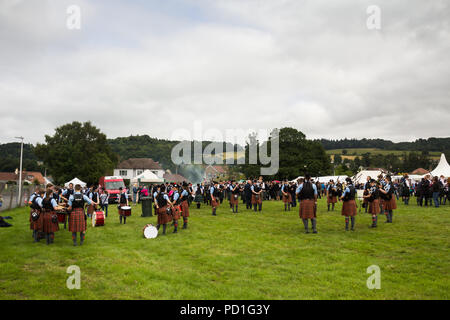 Stirling, Scotland, UK. 5th August 2018. Strathallan Games Park near Stirling is the venue for the 167th Bridge of Allan Highland Games.  Scottish pipe bands muster outside the main ring to tune their instruments and engage in a final practise, ready to compete in the pipe band competition. Credit Joseph Clemson, JY News Images/Alamy. - Stock Image
