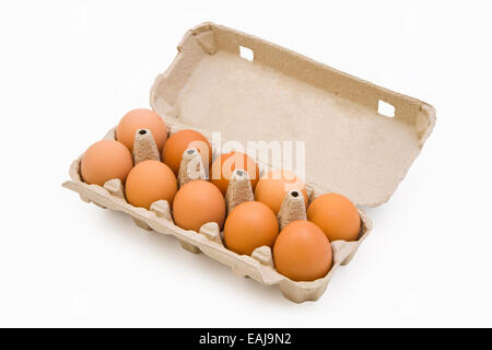 Chicken eggs in a carton box isolated on white - Stock Image