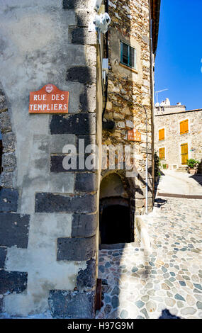 Rue de Templier; a street in the village of Grimaud, Var, South of France with no people on a sunny day. - Stock Image