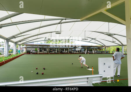Persons playing bowls at the Cooktown Bowls Club, Far North Queensland, QLD, FNQ, Australia - Stock Image