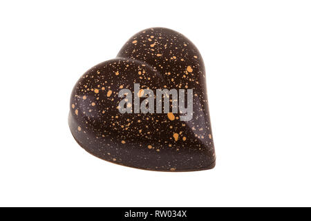 Chocolate candy in shape of heart isolated on white background with clipping path. - Stock Image