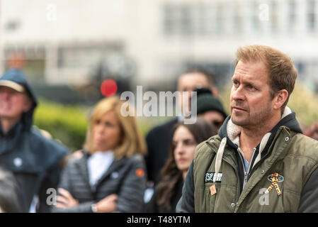 Dan Richardson listening to young female protester activist Bella Lack speak at a stop trophy hunting and ivory trade protest rally, London, UK - Stock Image