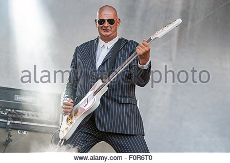 Triggerfinger performing live : Paul Van Bruystegem(bass) also known as Lange Polle and Monsieur Paul - Stock Image