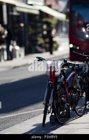 bicycles on a steet in stoke newington, hackney, london with blurred background and lovely bokeh - Stock Image