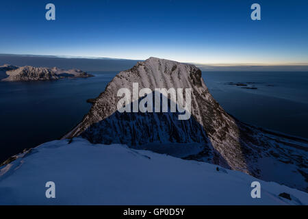 Moon shadow on Veggen mountain peak from Mannen, Vestvågøy, Lofoten Islands, Norway - Stock Image