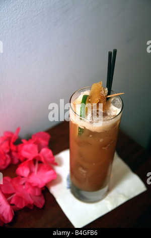 Exotic rum cocktail in tropical bar - Stock Image