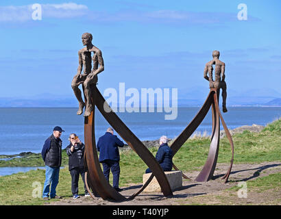 Visitors at 'Ship', metal sculpture by Anna Gillespie, 2019. Half Moon Bay, Heysham, Lancashire, England, United Kingdom, Europe. - Stock Image