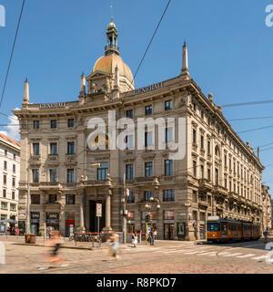 Square streetview of Palazzo delle Assicurazioni Generali in Milan, Italy. - Stock Image