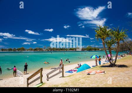 Gold Coast, AUS - JAN 12 2019: People enjoying beach activities at famous family beach at Tallebudgera Creek  Gold Coast, Queensland, Australia - Stock Image