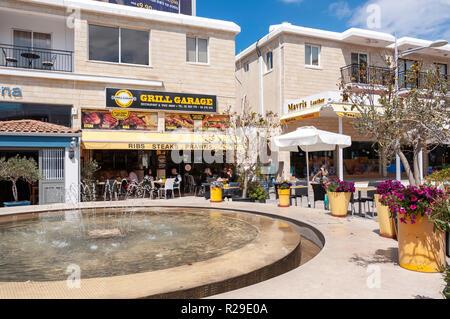 Grill Garage restaurant and fountain, Poseidonos Avenue, Paphos (Pafos), Pafos District, Republic of Cyprus - Stock Image