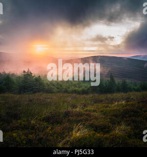 Misty sunset in Wicklow Mountains - Ireland - Stock Image