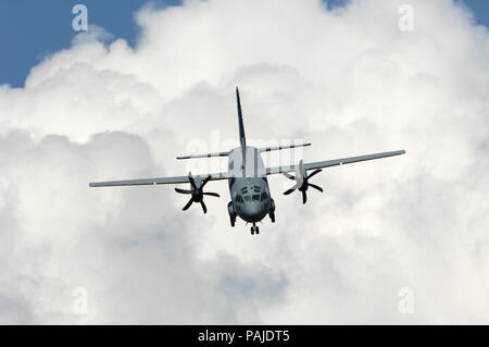Italian AirForce Alenia C-27J Spartan in the flying-display at the Paris-Airshow Salon-du-Bourget 2009 with cumulus clouds behind - Stock Image
