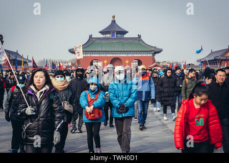 Tourists on Danbi Bridge in Temple of Heaven in Beijing, China - view with roof of Hall of Prayer for Good Harvests - Stock Image
