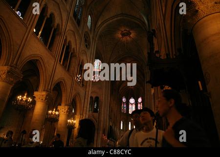 Visitors in the Notre Dame de Paris in Paris, France. - Stock Image