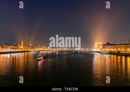 Night view of the Szilágyi Dezső Square Reformed Church and River Danube bank at Budapest, Hungary - Stock Image