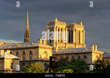 Wide angle view of the spire and the towers of Notre Dame at the golden hour, Paris, France - Stock Image