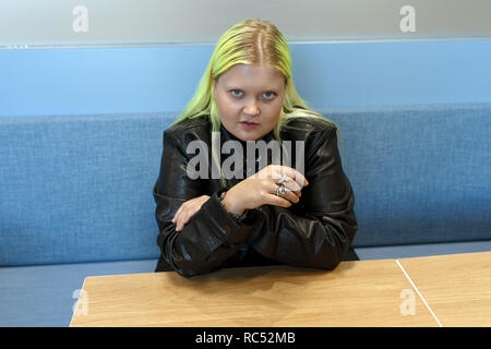 Alma, pop singer from Finland, poses for photographs in the lobby of a hotel during a visit to the United Kingdom in 2018. Alma-Sofia Miettinen, Alma musician, Alma pop artist. - Stock Image