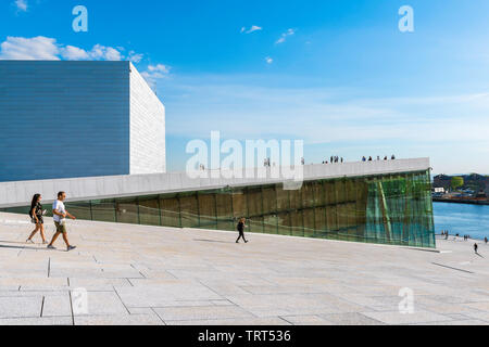 Opera House Oslo, view in summer of people walking on the vast access ramp leading to the roof of the Oslo Opera House. - Stock Image