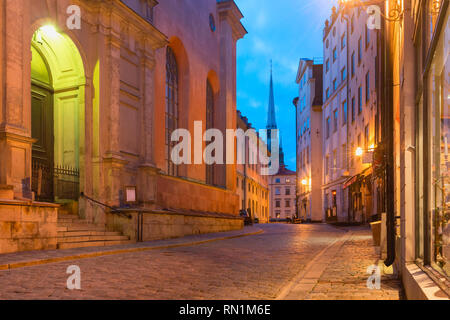 Empty street on the rainy night, Gamla Stan in Old Town of Stockholm, the capital of Sweden - Stock Image