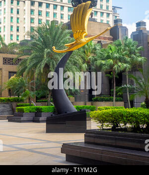 Sculpture yellow crane tower or golden crane bird in the plaza of Parkview Square Singapore. - Stock Image