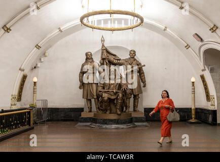 Woman walking on subway concourse, Belorusskaya Station, Moscow Subway, Russia - Stock Image