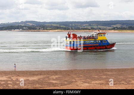 'Pride of Exmouth' ferry being watched from beach by a small girl. - Stock Image