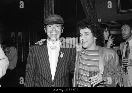 Elton John and Leo Sayer attending a House of Commons reception, invited along with other pop stars by the Minister for the Arts , Norman St John-Stevas. 3rd August 1980. - Stock Image