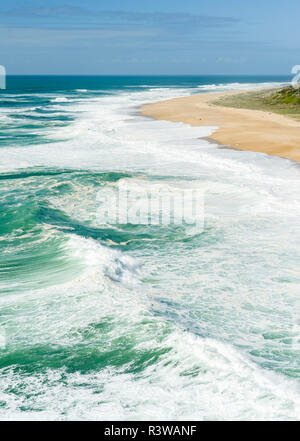 Huge breakers of Nazare with beach Praia do Norte. The town Nazare on the coast of the Atlantic Ocean. Portugal. - Stock Image