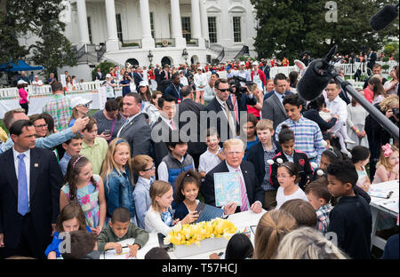 Washington, United States Of America. 22nd Apr, 2019. United States President Donald J. Trump shows off his artwork as he colors with children during the White House Easter Egg Roll at the White House in Washington, DC on April 22, 2019. Credit: Kevin Dietsch/Pool via CNP | usage worldwide Credit: dpa/Alamy Live News - Stock Image