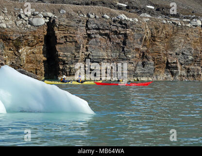 Kayaking in the arctic waters of Spitsbergen on the Svalbard Archipelago in the far north of Norway. - Stock Image