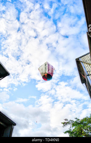 SHIFEN, TAIWAN - JUL 15, 2013: A sky lantern with wishes written on it floats into the skies at Shifen near Taipei, Taiwan. The town is a popular attr - Stock Image