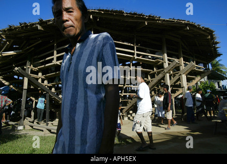 Filipinos outside a rural cockhouse in Oriental Mindoro, Philippines. - Stock Image