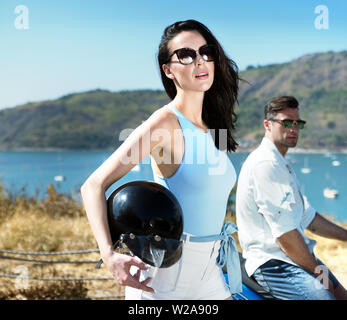 Young and relaxed couple on scooter journey - Stock Image