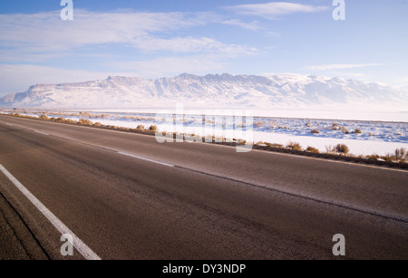 It's cold and bright along this patch of road in the Western USA - Stock Image