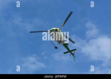 Aérospatiale/Eurocopter AS350 B3 'Écureuil' (Airbus Helicopters H125) in the air, seen from below. - Stock Image