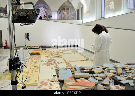 Reconstruction of the painting plasters from the calidarium walls of a roman villa, restorations in the church of Santa Marta, Rome, Italy - Stock Image