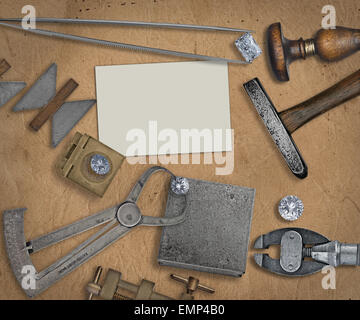 vintage jeweler tools and diamonds over  working bench, blank business card for your text - Stock Image