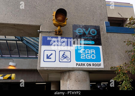 Car sharing signs at the entrance to a UBC parking garage or parkade on the campus of the University of British Columbia, Vancouver, BC, Canada - Stock Image
