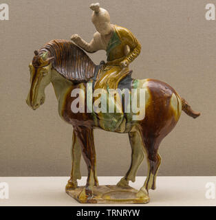 Tri-colored Glazed Pottery Figurine of Polo Player. 618 AD - 907 AD (Tang Dynasty) Luoyang City Culture Relics and Archaeology Research Institute. - Stock Image