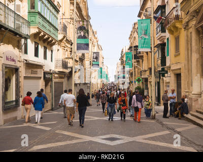 Visitors crowing in the Republic street,  tourist shopping centre and main pedestrian area in Valetta Malta - Stock Image