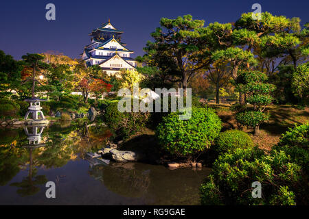 view on Osaka Castle from the garden at night, Japan - Stock Image