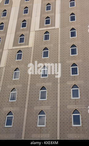 The windows on the exteriors of a building with traditional Islamic architecture. - Stock Image