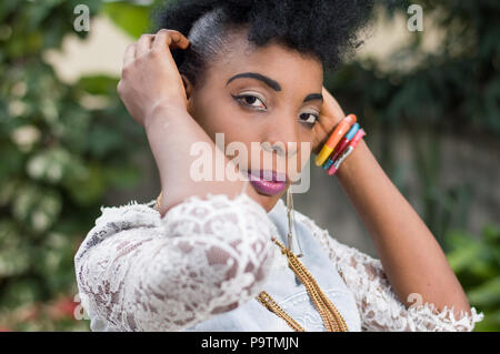 Closeup of pretty African woman posing outside - Stock Image