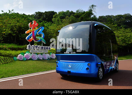 Fuzhou, China's Fujian Province. 24th Apr, 2019. A self-driving bus runs on a sight-seeing path in the Feifeng Moutain smart park in Fuzhou, capital of southeast China's Fujian Province, April 24, 2019. The Feifeng Mountain smart park, the first AI park of Fujian province, opened in Fuzhou recently. Credit: Wei Peiquan/Xinhua/Alamy Live News - Stock Image