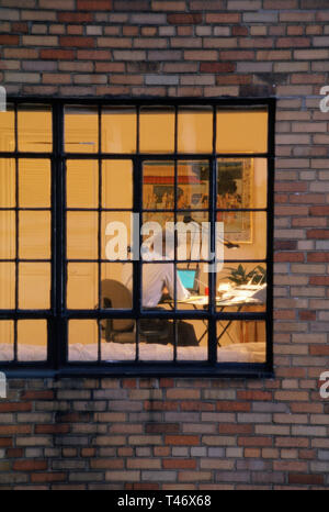Man Working late in high-rise apartment Home Office, NYC, USA - Stock Image