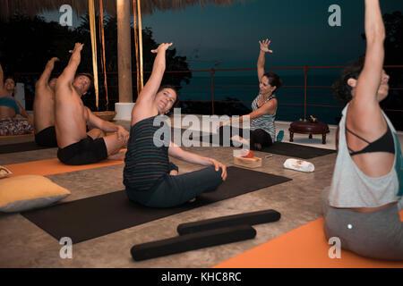 Group of people practicing. Yoga retreat Puerto Vallarta - Mismaloya, Mexico - Stock Image