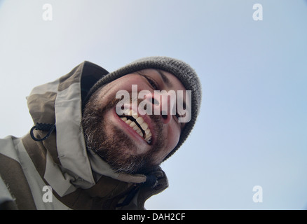 Man smiling on a winter day - Stock Image