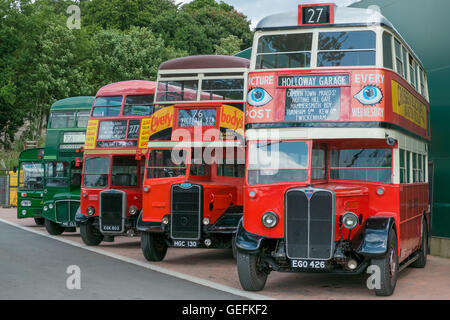 WEYBRIDGE, SURREY, UK - AUGUST 18: A line of vintage red and green vintage London buses. - Stock Image