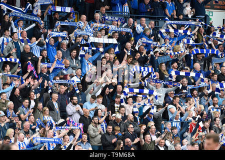 Kilmarnock fans celebrate after seeing their team defeat rangers 2-1 during the Ladbrokes Scottish Premiership match at rugby Park, Kilmarnock. - Stock Image