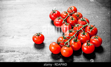 Fresh ripe tomatoes. On black background - Stock Image